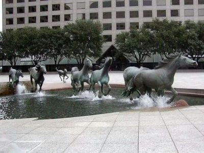 A water fountain in Texas creating the illusion of the horses moving