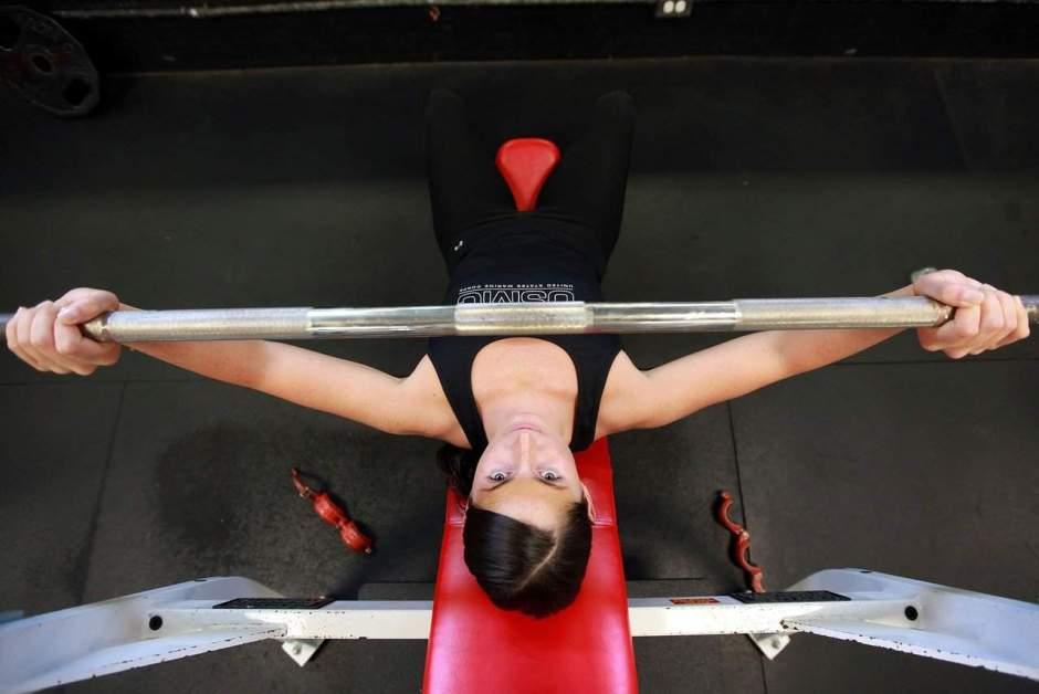 woman bench-pressing