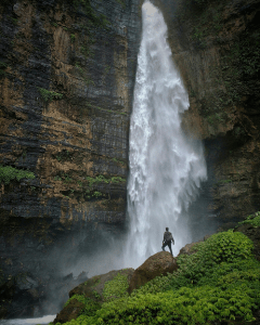 hiker at waterfall