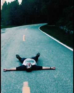 Laying in the middle of the highway