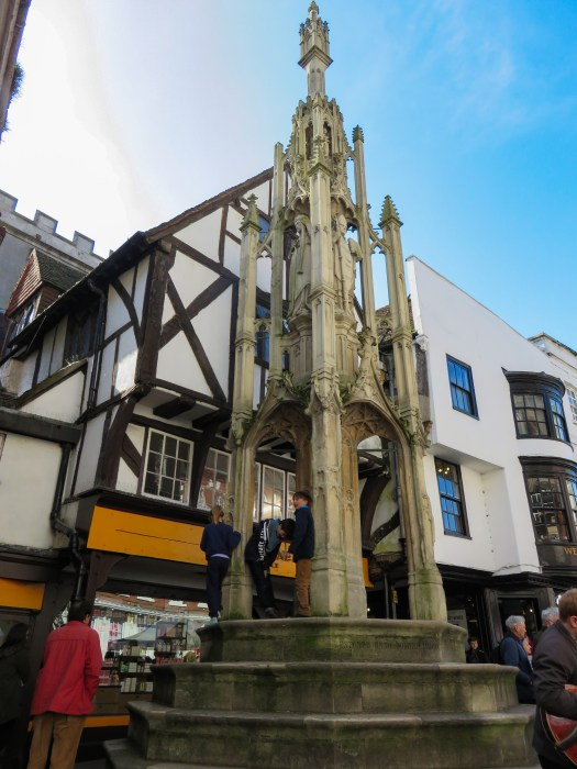 buttercross monument in winchester england with godbegot house shown behind