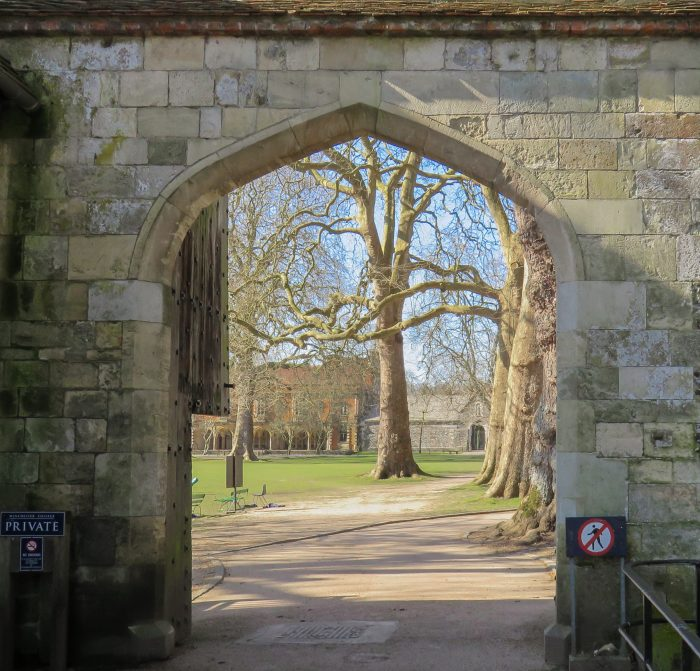 stone gate entrance to winchester college england