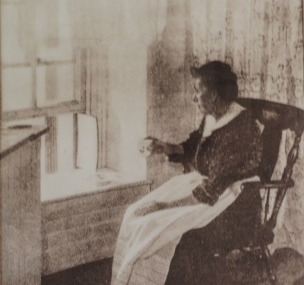 Historic image of Katherine Walker at the window of Robbin's Reef Lighthouse. Photo: Andrew Moszenberg for Life-Wire News Service.