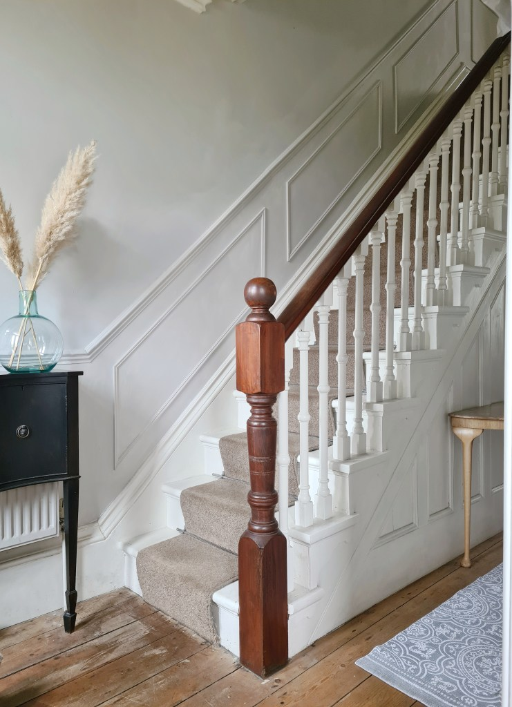 Victorian staircase with original panelled detail and wall panelling painted in Cornforth White.