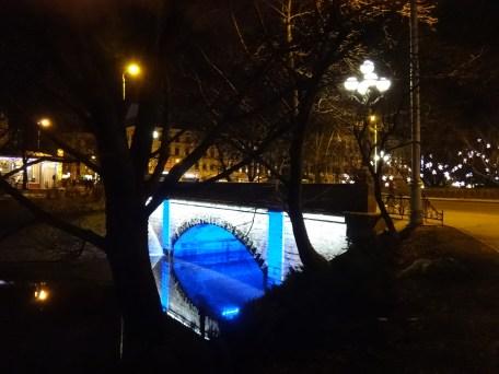 Blue light under a bridge