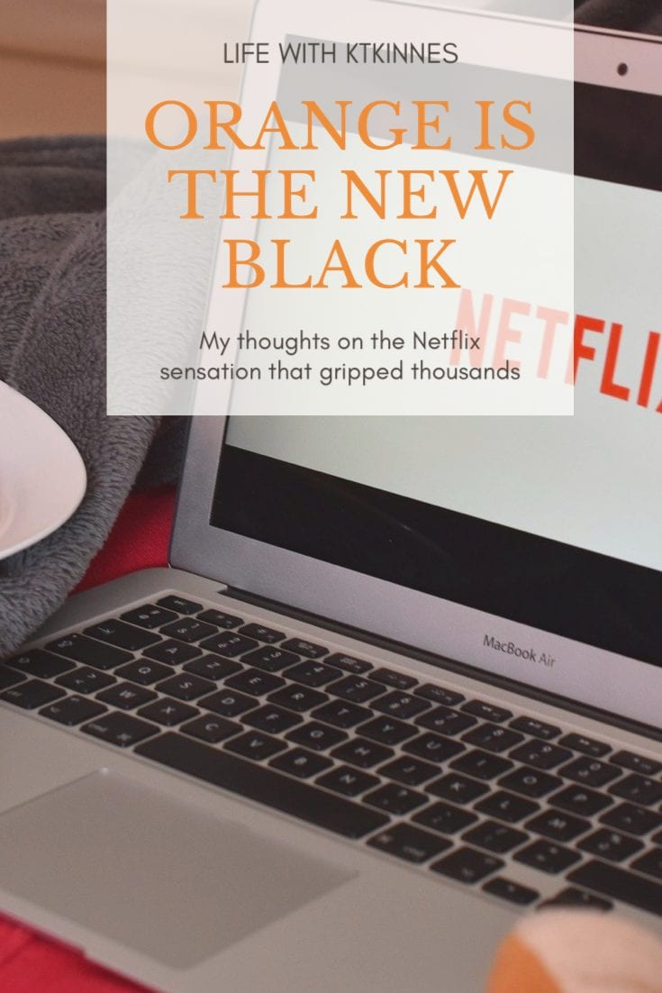 """Background is a silver laptop opening Netflix. Foreground, in orange writing, are the words """"Orange is the New Black""""."""