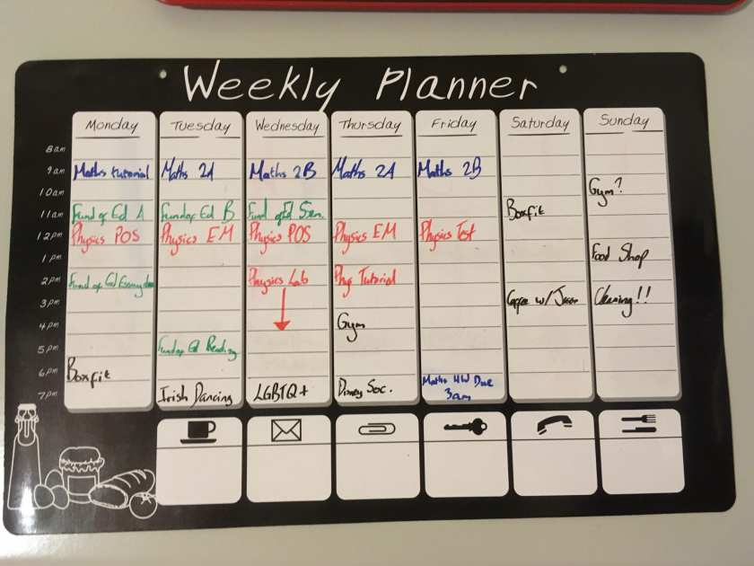 A magnetic white board of a weekly planner