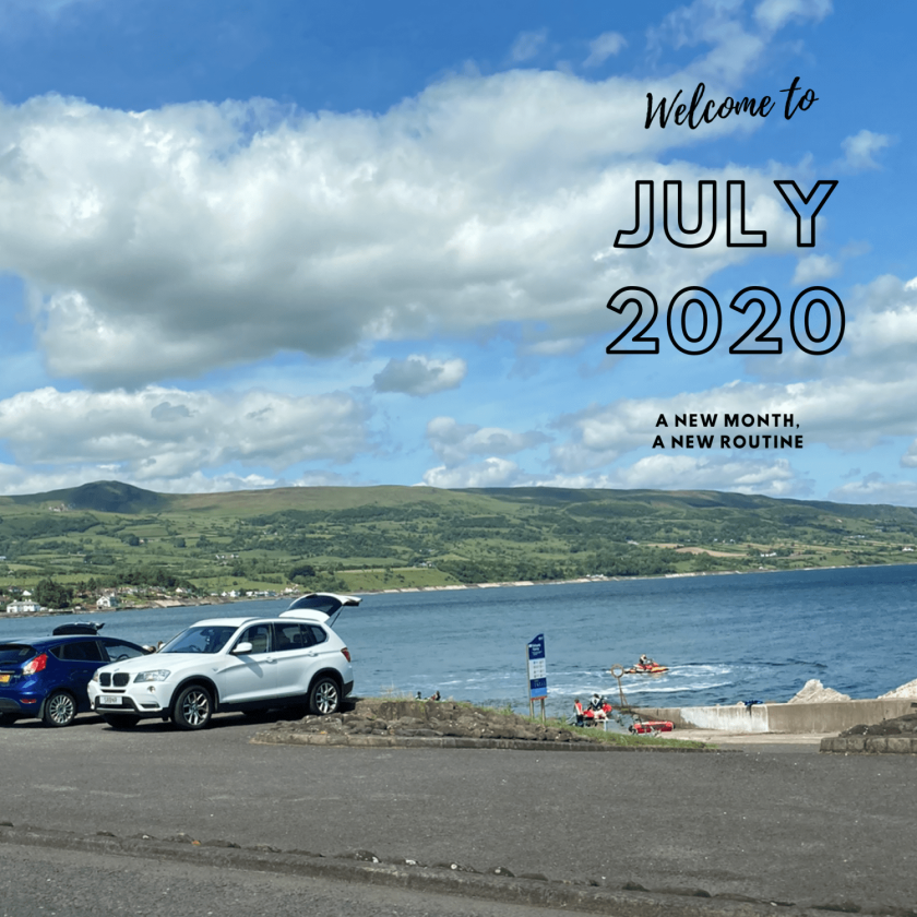 A view of Fairhead from the coastal road in the background. In the foreground, in black writing, is July 2020