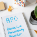 Notepad on a desk with the initials BPD and then Borderline Personality Disorder written in blue