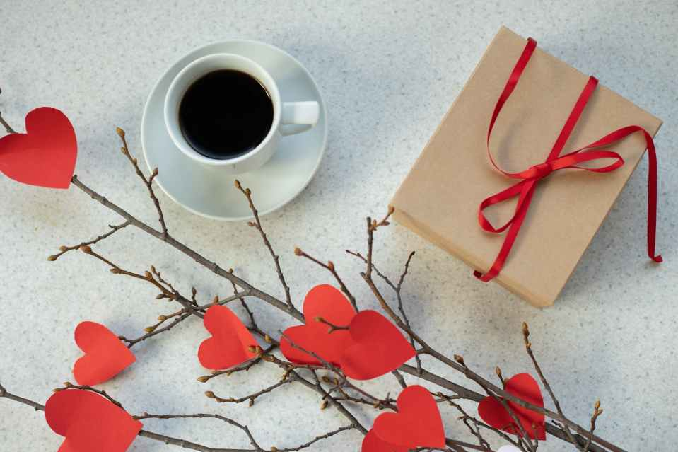 coffee near present and handmade bouquet