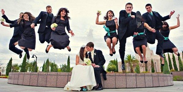 awkward wedding photos bridal party jumping into air