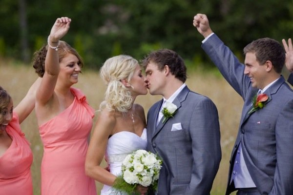 bridal party kiss cheering