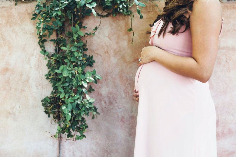 ASOS blush pink ruffle maternity dress. Click to see the rest of the photos from this tea party baby shower on the blog!