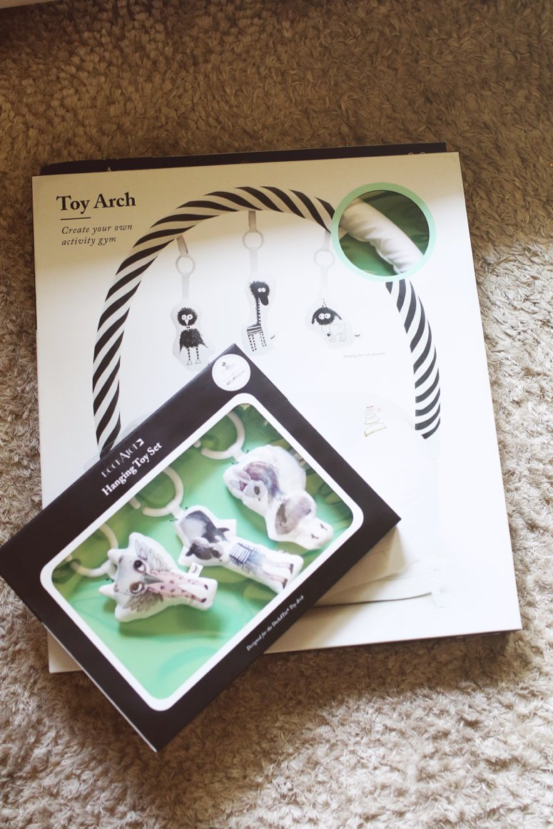 DockaTot toy arch and toy set. DockaTot review, click to see how we use this and if its really worth the investment!
