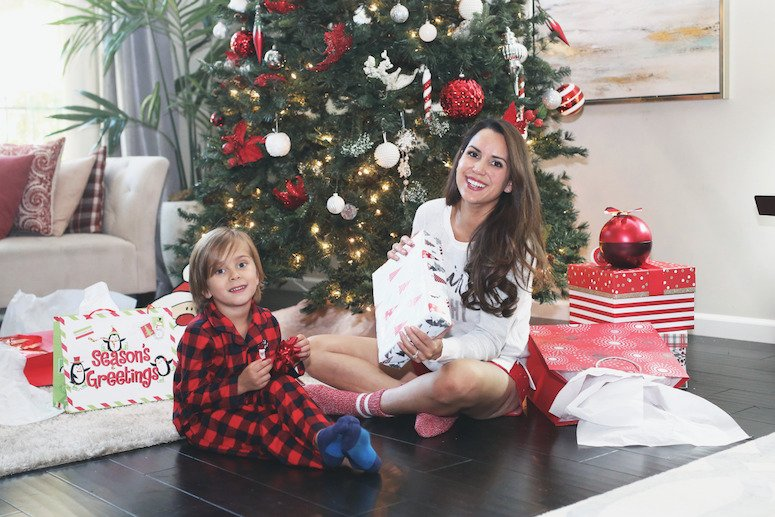 toddler christmas gift list and ideas   mom and toddler sitting under christmas tree together   lifewithmar.com