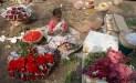 Stringing flower garlands in the Dadar flower market.