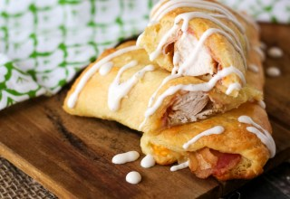Ranch Chicken Club Roll-Ups are my most popular recipe. Cheese, ranch, bacon and chicken all wrapped up in a buttery crescent makes an easy dinner!