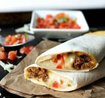 Copycat Meximelts are a drive thru favorite you can make at home! Melty cheese, flavorful beef and pico make these a family favorite!