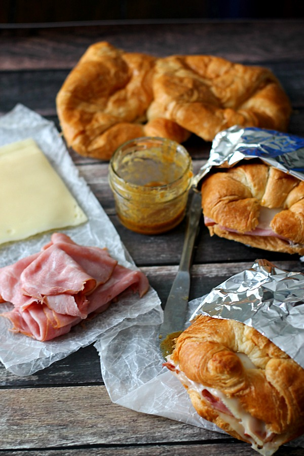 Hot Ham & Swiss Croissants, buttery croissants, melty cheese and a honey mustard sauce all melt together to make the perfect sandwich.