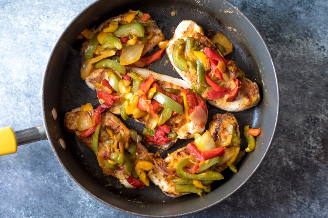 Fajita Topped Pork Chops are the quick and flavorful dinner you will want to make every week! So easy, cheesy and delicious!