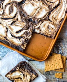 S'mores Slab Pie is the perfect dessert! Graham cracker crust, fudgy pie and that marshmallow swirl are out of this world!