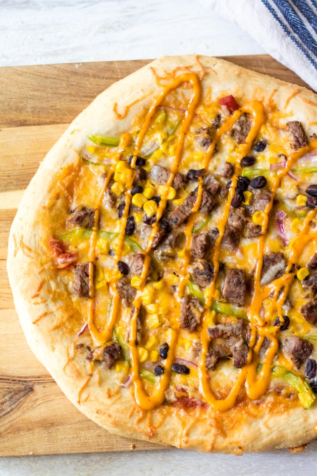 Steak Fajita Pizza will be your new favorite! Homemade crust topped with steak, corn, black beans and peppers and onions make the BEST pizza!