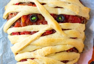 Mummy Meatloaf is a spooky and delicious Halloween dinner your little ghouls and goblins will love! Flavorful meatloaf wrapped in crescent mummy strips yum!