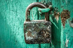 Rusty Padlock On Blue Door ALT