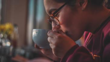 Chinese woman drinking warm hot coffe debunking coffee myths LIFEXPE