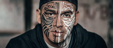Man with face tribal design tatoo quote smile every individual matters lifexpe