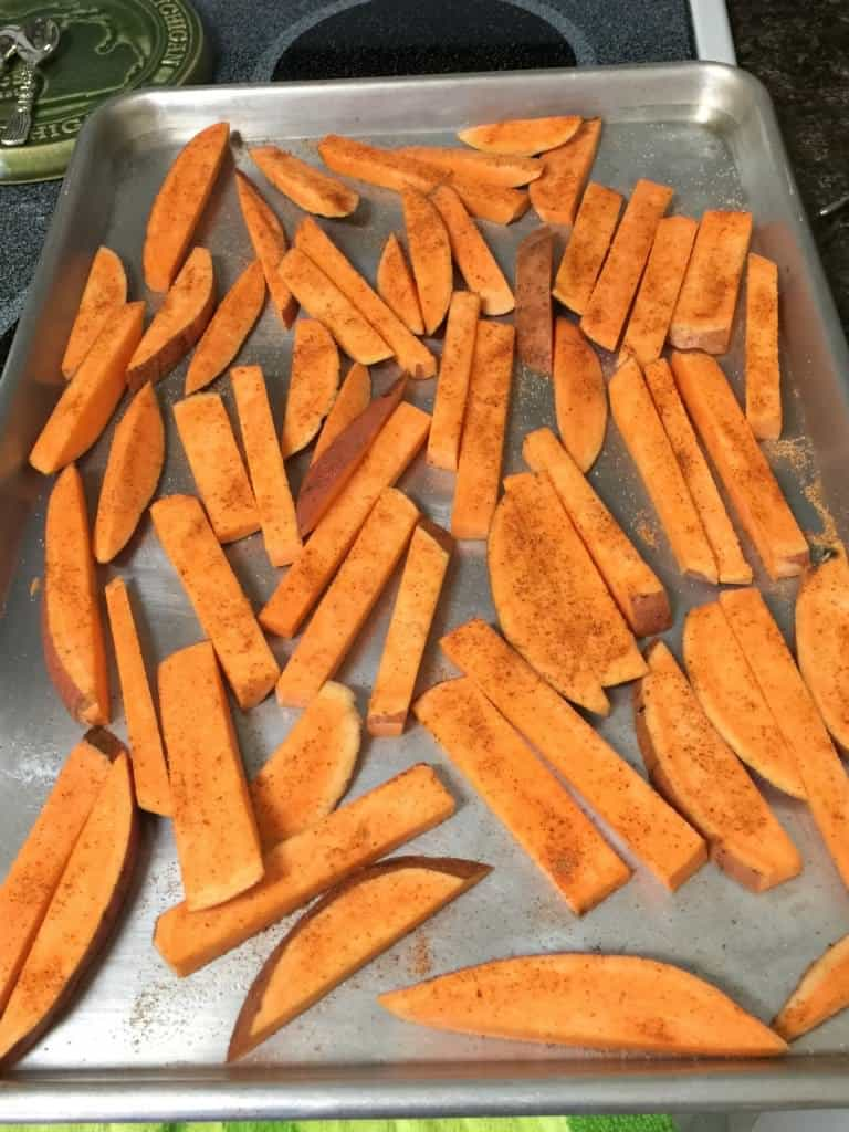 seasoned sweet potato fries in single layer on baking sheet