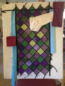 A fabric wall hanging being worked on