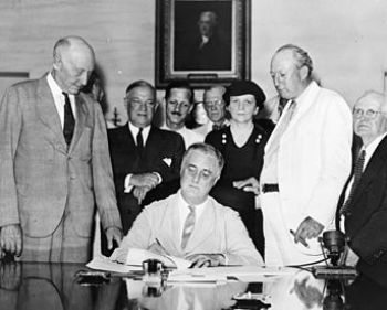 Roosevelt Signs The : President Roosevelt sign...