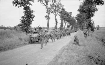 Men of the 8th Royal Scots move forward