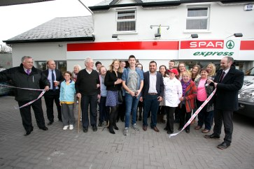 Pictured at the Official Rebranding of the SPAR Express in Bunratty Co Clare where Fair City's Ryan Andrews cut the ribbon with owner Mohammad Muhtar Warich and SPAR Marketing Manager Anne Gallagher.Pic Arthur Ellis.