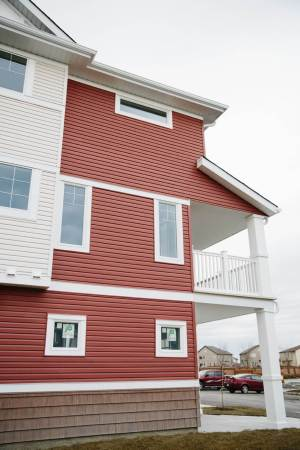 Multifamily new construction project with different coloured siding