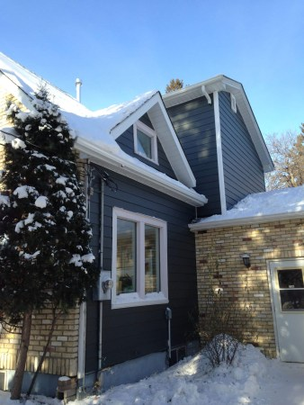 New siding on home during Winnipeg winter