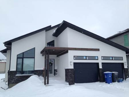 Modern, new home construction in Winnipeg with custom Hardie siding