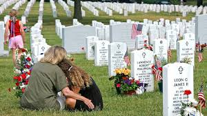 family besides soldier's grave