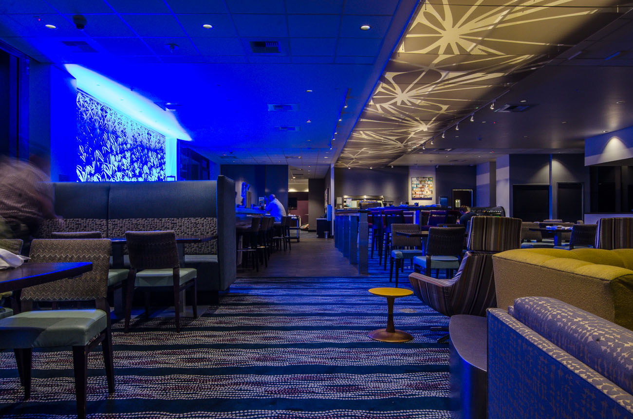 Sultry blue lighting surrounds the 24 foot bar