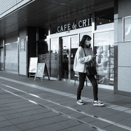 Woman in front of the cafe