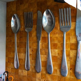 Huge spoon hanging on the wall