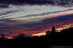 The sun sets behind the Schlossberg, Graz, Austria.