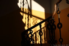 the stairs in my house in late afternoon shadow.