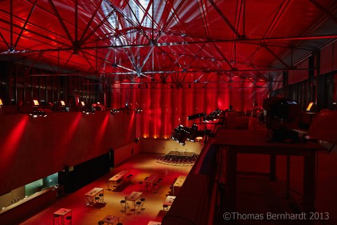 """A look over the foyer of the Helmut List Halle, Graz, Austria, during the Steirischer Herbst 2013 festival. Design by Madame Offenhauser and myself. The aim was to get a """"lounchy"""" feeling, using a lot of the festivals CI colour, which is... corrcet, red."""