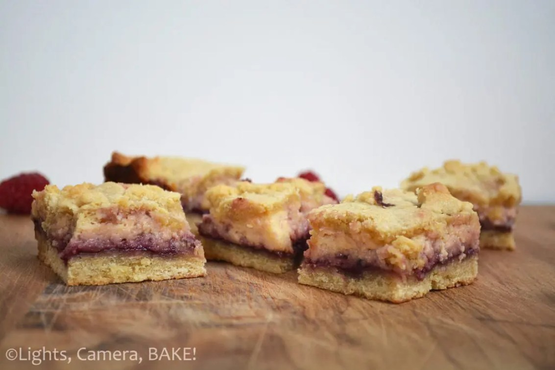 Boysenberry Cheesecake Shortcake. A soft and crumbly shortcake base an topping with boysenberry jam and a soft and creamy cheesecake in the center. These are massive hit with my family. #boysenberrycheesecake #boysenberryshortcake #shortcakerecipe