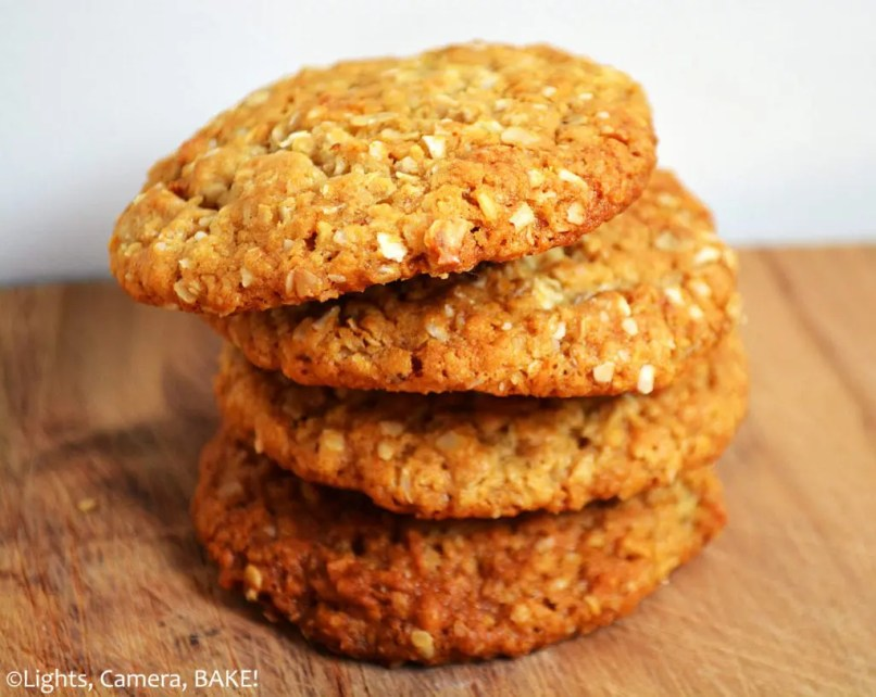 ANZAC Biscuits. A classic crunchy, chewy biscuits with a soft interior with a strong caramel like flavour with hints of coconut. #oatcookies #ANZACBiscuits #carameloatcookies #coconutcookies