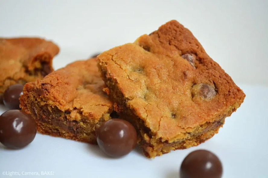 Malteser Cookie Bars are chewy and gooey, packed full of malt, chocolate and Maltesers to make these taste like Maltesers in cookie bar form. #maltesercookies #maltedcookies #maltesersrecipe