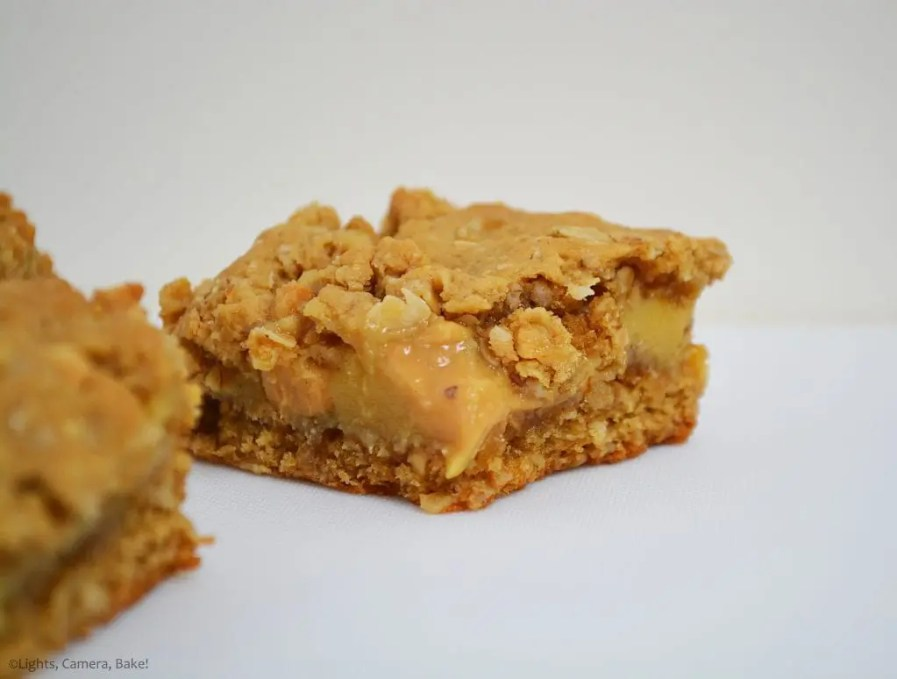 Peanut Butter Caramel Oat Slice close up of the slice which has a gooey condensed milk caramel and peanut butter middle and crunchy oat outside