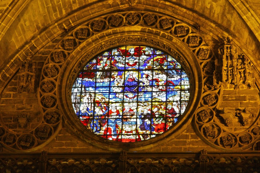 Stained glass window and detailed masonry work.